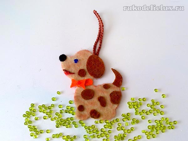 Suspension - a small dog made of felt